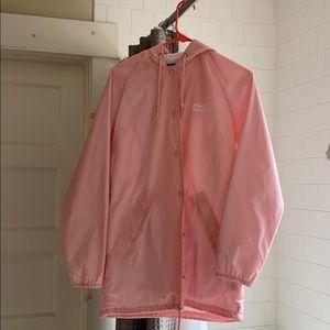 A pink obey windbreaker